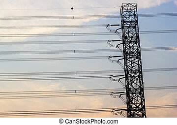 Electricity pylon in the background of evening sky, horizontal lines.