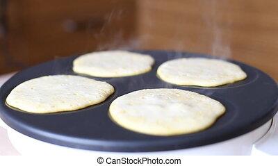Making Pumpkin Pancakes on Frying Pan. Homemade Griddle...