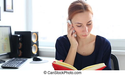 The girl in the office talking on smartphone