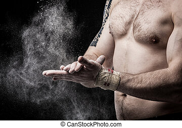 Close-up photo of a muscular torso and hands isolated on...