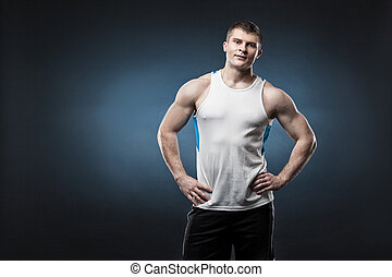 Sporty and healthy man isolated on dark blue background