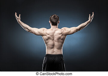 Muscular male back isolated on dark blue background