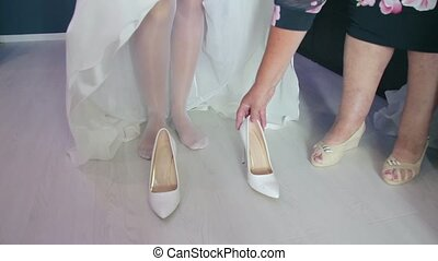 Bride Dresses wedding shoes - helping the bride to wear...