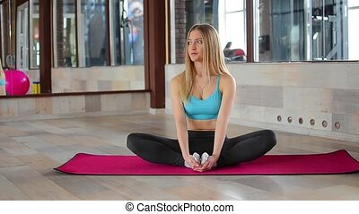 Woman doing stretching yoga exercises