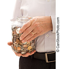 Senior man hands holding jar with coins closeup - retirement...