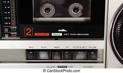 Pushing Button on the Audio Cassette Player - Pushing a...