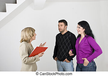 Couple meeting with estate agent - Young couple having a...