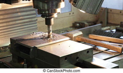 Drilling machine making a hole in a steel bar. Full HD