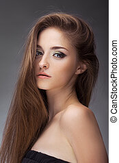 Fashion girl in studio - Young brunette lady in black dress...