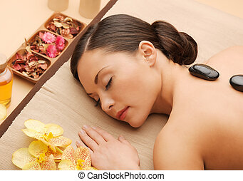 beautiful woman with hot stones - picture of woman in spa...