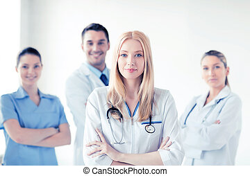 female doctor in front of medical group - attractive female...
