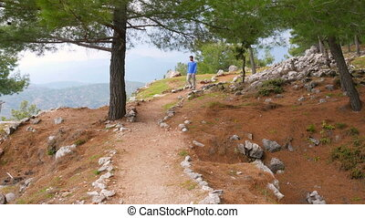 quot;tourist man walking trekking historical lycian way,...
