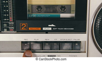 Pushing a Finger Button Rec and Stop on a Tape Recorder. -...