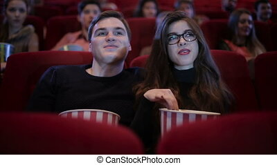 Couple on a date at cinema - Young couple waching a movie...