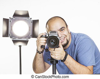 professional photographer with photographic equipment -...