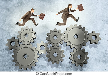 Two businessmen running on wheel gears - Two businessmen...