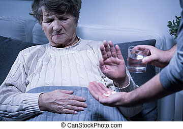 Take it away from me - Shot of a senior woman refusing to...