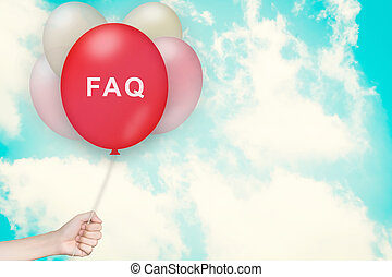 Hand Holding FAQ or Frequently asked questions Balloon with...