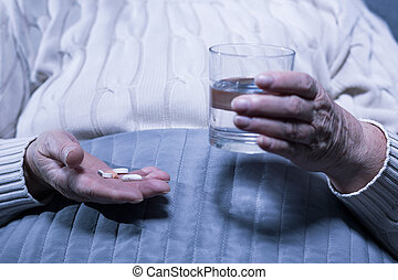 Taking her medication every day - Cropped picture of an old...
