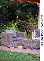 Beautiful wicker furnitures on the back yard