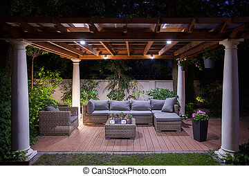 Relaxing area outside of mansion - Photo of relaxing area...