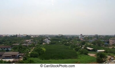 Outskirt of Bangkok viewed from the - The Airport Rail Link...