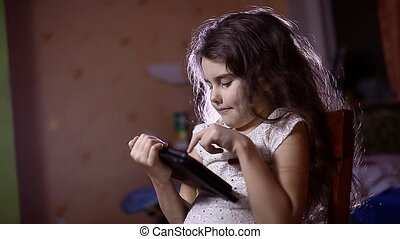 teen girl with a tablet in room browsing Internet - teen...