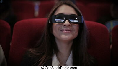 Woman watching movie in cinema