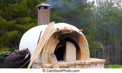 quot;brick, clay oven fire outdoor in forest garden...