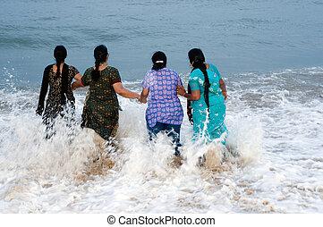 family having fun at a local beach