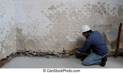 Construction worker in action - Construction worker holding...