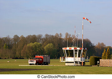 Small airstrip - Control tower and fire truck of a small...