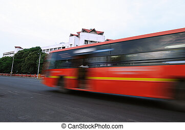 Speed - A local city bus driving very fast inside the city