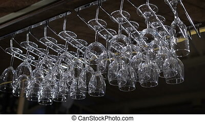 hanging wineglasses, selective focus, color reflections. the...