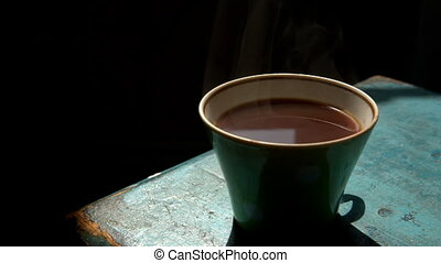 Cup of hot fresh coffee on the blue table