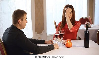 man and woman in restaurant rendezvous romantic evening...