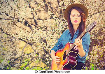 portrait of young woman with guitar - portrait of the...