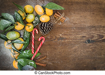 Christmas or New Year frame. Fresh mandarins with leaves,...