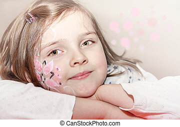 young girl with body painting on face - portrait of cute...