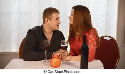 man and girl in restaurant  rendezvous Valentine's Day romantic evening candles wine