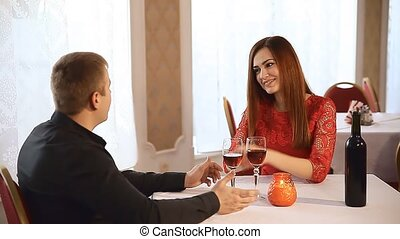 man and woman in restaurant rendezvous romantic Valentines...