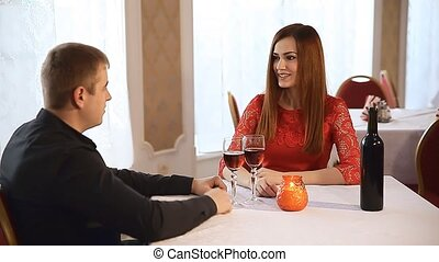 man and woman in restaurant rendezvous romantic evening candles wine