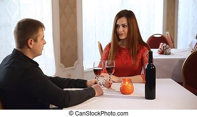 man and woman in a restaurant rendezvous romantic evening candles wine