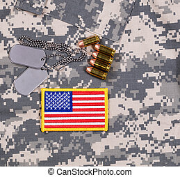 USA flag patch, ID tags, bullets on military battle dress...