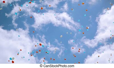 Many red, white, blue air balloons fly in beautiful cloudness sky. Colors of national Russian flag