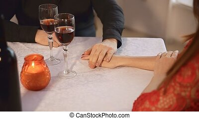man and woman in Valentine's Day restaurant  rendezvous romantic evening candles  wine