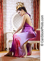 muse - woman wearing pink night dress in her room of luxury...