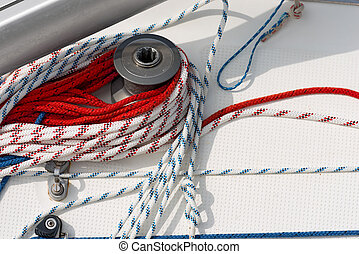 Winch with Ropes on a Sailboat - Detail of a sailboat deck...