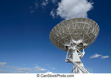 Huge antenna dish at Very Large Array, searching for imaging...