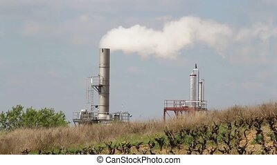 Smokestack of industrial factory - Industrial factory...